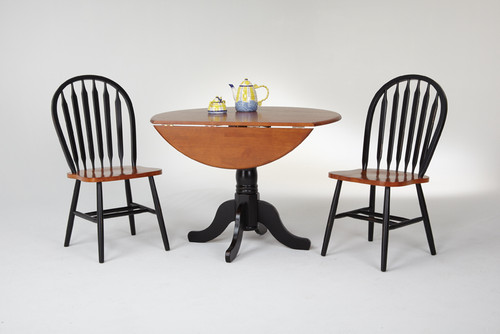 """42"""" Round Drop Leaf Table  Solid Wood Only 24"""" with leaves down Shown with Fanback Chairs  Black & Cherry Finish"""