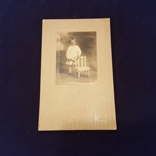 Antique Photo Boy in white dressing gown standing next to a chair.