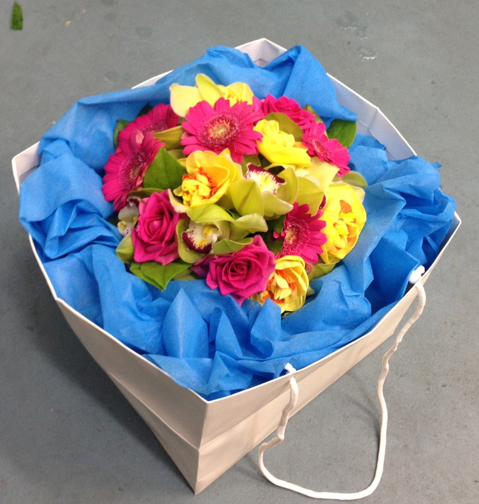 Bright bouquet including Gerberas, Double Daffodils and Orchids