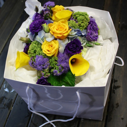 Seasonal yellow, blues and purples in a carry bag.