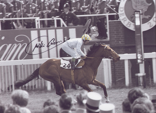 Carson won the Derby for the first time on the brilliant colt Troy in the 200th running of the famous Epsom showpiece in 1979. Superb signed action photograph of Carson crossing the winning line.