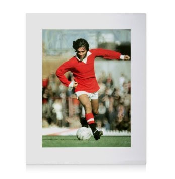 Superb print showing Manchester United's George Best in action for Manchester United against Ipswich in 1971. (Photograph Colorsport). The print is professionally reproduced with a UV finish.