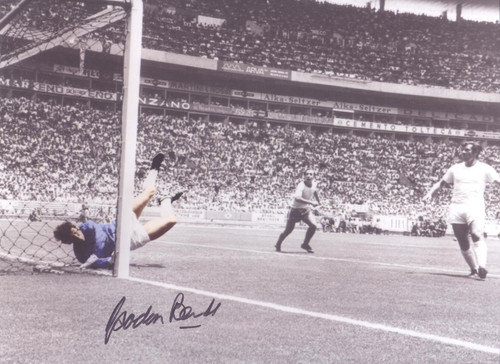 Superb action picture showing England goalkeeper Gordon Banks making what many regard to be the greatest save ever. This stunning picture celebrates the iconic moment in Guadalajara during the 1970 World Cup when one of the world's greatest goalkeepers denied the world's greatest player with what became known as the 'Save of the Century'. The photo is personally signed by Banks and is a stunning piece of sporting memorabilia that captures a truly iconic moment of World Cup history.