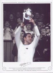 Derby County captain Dave Mackay holds aloft the 2nd division championship trophy after the Rams had finished 'Top Dogs' of Division 2 in the 1968/69 season.