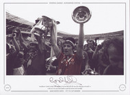 Manchester United's Gordon Hill and Stuart Pearson hold aloft the cup after defeating Liverpool 2-1 in the 1977 FA Cup Final