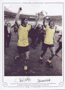1971 FA Cup Final. Arsenal Captain Frank McLintock and match winner Charlie George hold aloft the FA Cup, on their way around Wembley Stadium.