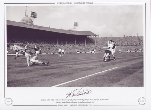 England's striker Bobby Smith scores his country's 5th goal past Scotland goalkeeper Frank Haffey in the 73rd minute, during a Home Championship game at Wembley stadium in 1961.