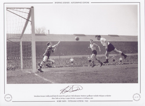 Tottenham Hotspur's Bobby Smith scores his teams first goal against Wolverhampton Wanderers goalkeeper Malcolm Finlayson as defender Slater looks on, during a League division 1 encounter in 1960.