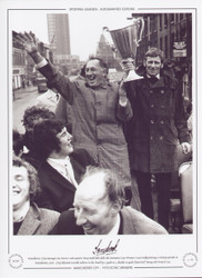 Manchester City manager Joe Mercer and captain Tony Book hold aloft the European Cup Winners Cup trophy during a victory parade in Manchester, 1970.