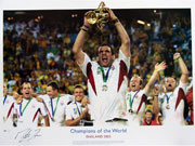 The final of the 2003 Rugby world Cup was a thrilling encounter, decided in the dying seconds by a sensational Jonny Wilkinson drop goal. Under the inspirational leadership of Martin Johnson, England had beaten Australia in their own back-yard by 20 points to 17 to become champions of the world. This Stunning limited edition hand signed picture captures the moment when Johnson lifts the Webb Ellis Trophy and is a fitting tribute to England's finest rugby moment.