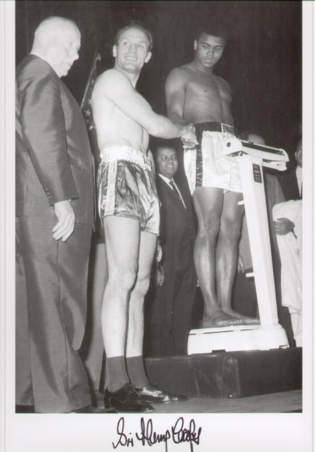 Henry Cooper V Cassius Clay 1963. Great iconic signed picture of the Weigh-in. Check out the shoes and socks! Superb picture from a great era in boxing.