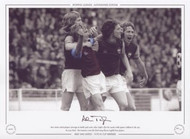 West Ham United players converge on double goal scorer Alan Taylor after his second strike against Fulham in the 1975 FA Cup Final. The Hammers won this final using eleven English born players.