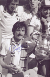 West Ham United's Alan Devonshire celebrates winning the 1980 FA Cup, a 1-0 victory against Arsenal. The photograph was signed by Alan Devonshire at a commercial signing session held January 2010.