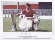 Phil Neal poses with the UEFA Cup, the Charity Shield and the League Championship trophy after Liverpool's successful 1975/76 season.