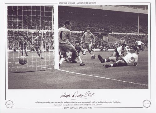 England's Bryan Douglas scores past Brazilian goalkeeper Gilmar, during an International friendly at Wembley Stadium in 1963. The Blackburn Rovers star's late equaliser cancelled out Pepe's strike for the South Americans.
