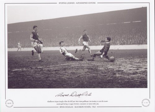 Blackburn's Bryan Douglas slides the ball past West Ham goalkeeper Jim Standen, to score his team's second goal during a league division 1 game at Upton Park in 1963.