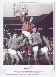 Manchester United's David Herd & Bill Foulkes hoist Denis Law shoulder high as he holds aloft the League Division One Championship trophy at Old Trafford in May 1965.