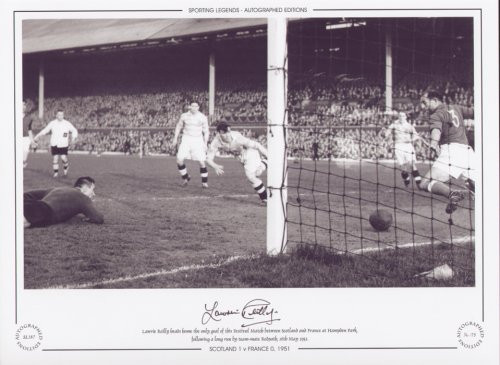 Lawrie Reilly heads home the only goal of this Festival match, between Scotland and France at Hampden Park following a long run by team-mate Redpath on 16th May 1951.