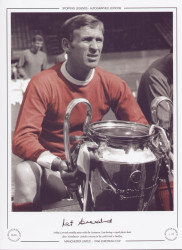 Manchester United legend, Paddy Crerand proudly poses with the European Cup during a squad photo shoot after Manchester United's victory in the 1968 Final V Benfica.