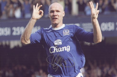 Superb Handsigned iconic photograph showing Andy Johnson celebrating after he scores his second goal and Everton's third in their historic derby win over Liverpool at Goodison on 9 September 06.