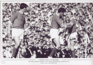 Bill Foulkes restrains his Manchester United team-mate Nobby Stiles after a disagreement with Pat Crerand at Old Trafford in 1966.