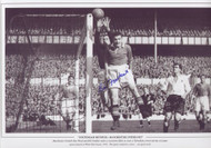 Manchester United's Ray Wood and Bill Foulkes make a concerted effort to clear a Tottenham corner during a League game played at White Hart Lane, 1953. The game ended in a 1-1 draw.