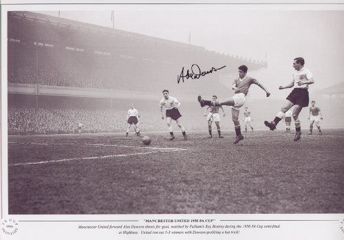Manchester United forward Alex Dawson shoots for goal, watched by Fulham's Roy Bentley during the 1958 FA Cup semi-final at highbury. United ran out 5-3 winners with Dawson grabbing a hat trick!
