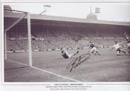Tottenham Hotspur's Bobby Smith blasts his team's second goal past the Burnley keeper Adam Blacklaw in the 1962 FA Cup Final.