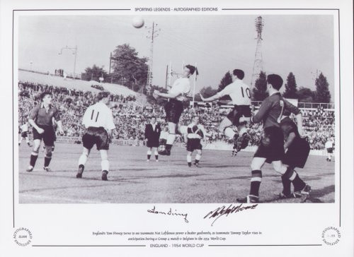 England's Tom Finney turns to see teammate Nat Lofthouse power a header goalwards, as Tommy Taylor rises in anticipation during a group 4 match V Belgium in the 1954 World Cup. Superb picture signed by two legends of English football.