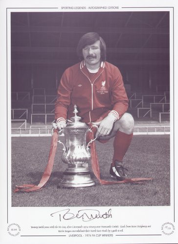 Tommy Smith poses with the FA Cup, after Liverpool's 1974 victory over Newcastle United. Goals from Steve Heighway and Kevin Keegan overwhelmed their North East rivals by 3 goals to nil.