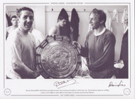 The 1967 Charity Shield is shared between Tottenham Hotspur's Dave Mackay and Manchester United's Denis Law. The sides had just played out a thrilling 3-3 draw at old Trafford. The game also saw Tottenham keeper Pat Jennings score direct from a kick out! Superb picture signed by two greats of British football.