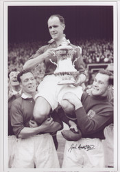 Manchester United's Charlie Mitten and Jack Crompton chair their Captain, Johhny Carey as he clutches the FA Cup after victory in the 1948 Final.