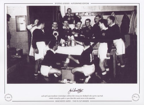 24th April 1948, Manchester United players celebrate their victory over Blackpool in the 1948 Final FA Cup Final. United's victory by 4 goals to 2 gave them their second success in the competition.