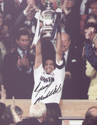 Spurs captain Gary Mabbutt lifts the FA Cup after a hard fought 2-1 victory over Nottingham Forest in the 1991 FA Cup Final.