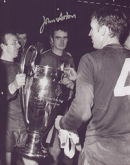 Manchester United's John Aston, Nobby Stiles & Bill Foulkes celebrate with the European Cup at Wembley in 1968. Superb photograph signed in silver sharpie marker.
