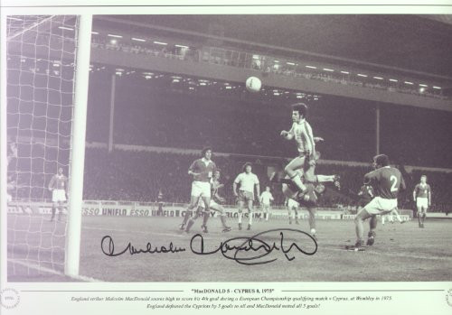 Malcolm MacDonald 5 V Cyprus 0 1975. England striker Malcolm MacDonald soares high to score his 4th goal during a European Championship qualifying match V Cyprus, at Wembley in 1975. England defeated the Cypriots by 5 goals to nil and MacDonald netted all 5 goals!