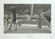 European Cup Winners Cup Semi Final 1985. Andy Gray celebrates scoring the second goal in Everton's famous 3-1 victory over Bayern Munich at Goodison in 1985. Signed under the Big Blue tube label. Superb piece of Everton memorabilia.
