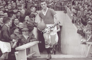Bill Foulkes leads out Manchester United.