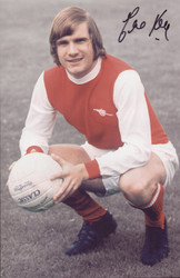 "Arsenal legend Eddie Kelly poses for the camera in the 1970s. The photograph is 12"" x 8"" (305mm x 205mm) and has been signed by Eddie Kelly."