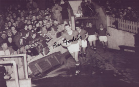 Captain Bill Foulkes leads out Manchester United for their first game post Munich, 19th February 1958. (FA Cup 5th Round).