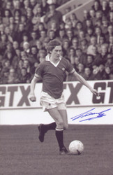 Republic of Ireland international Gerry Daly in action for Manchester United in the 1970's, signed 12x8 photograph.