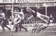 Superb action photograph of West Ham United legend Frank McAvennie. Great Value. The photograph has been signed by Frank McAvennie at a commercial signing session held on 10 March 2010.