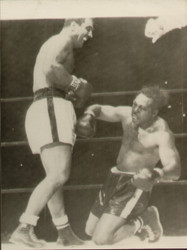 On offer is an original radio/wire photograph showing Rocky Marciano knocking down Archie Moore in the sixth round of the World Heavyweight title fight held at the Yankees Stadium, New York in front of over 61000. Marciano retained his title after finally knocking Moore out in the ninth round.