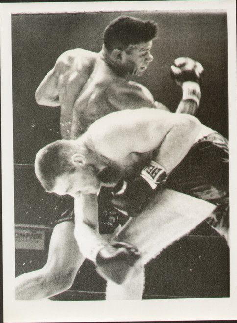 On offer is an original radio/wire photograph showing World Heavyweight Champion Floyd Patterson in action against Tom McNeeley in the third round of their title fight held on December 4, 1961 at Maple Leaf Gardens in Toronto. Patterson retained his title after finally knocking McNeeley out in the fourth round.