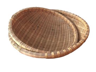 Pair of round handwoven baskets, circa 1960s