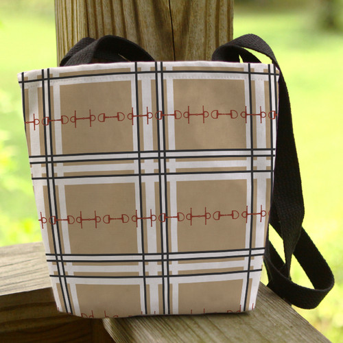 tan plaid horse bits tote bag