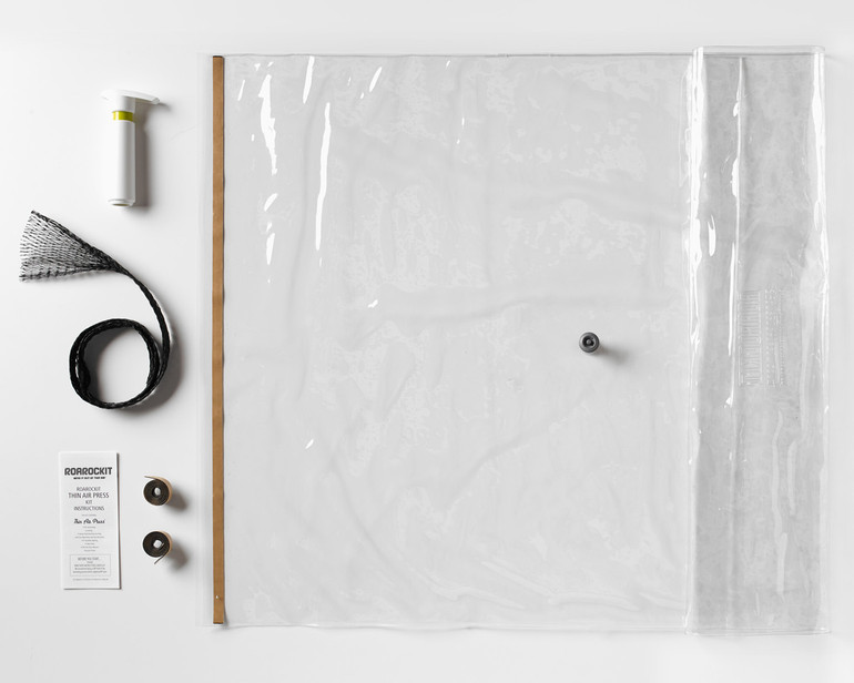 The Roarockit Thin Air Press Kit Parts: vacuum bag with seal and one-way valve, Super Pump, breather, extra seals and illustrated instructions