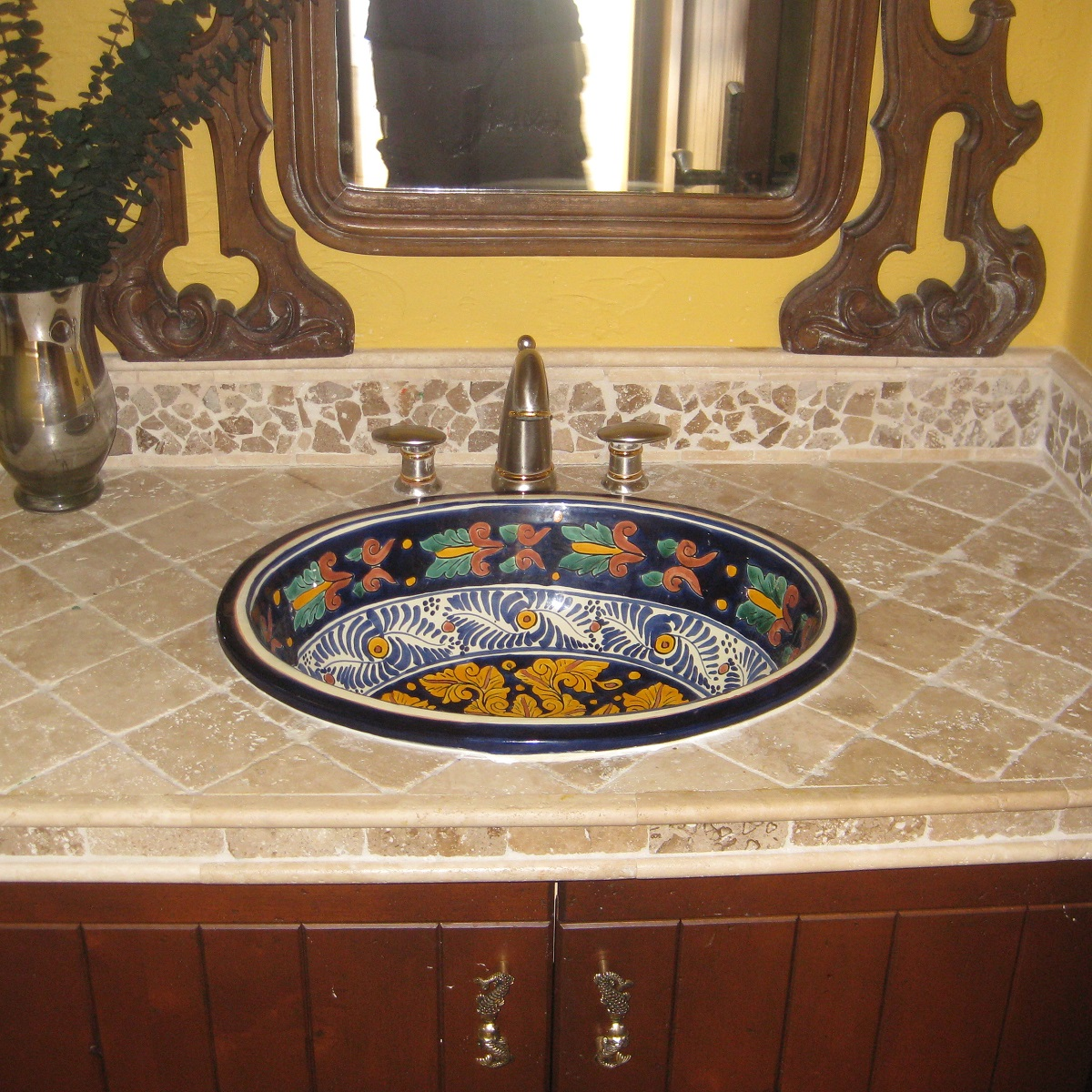 mexican tiles and talavera sinks in rustic bathroom