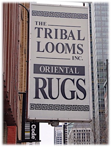 The Tribal Looms Sign