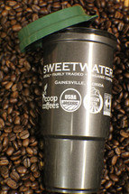 Insulated 16 ounce travel mug with Sweetwater coffee logo.